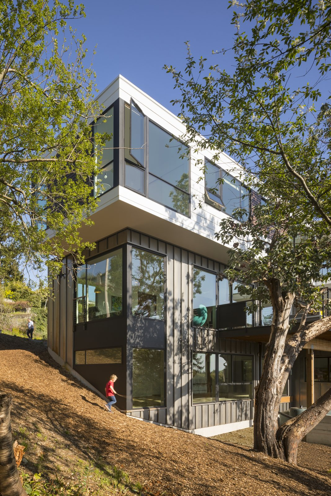 Exterior, Flat, Tile, Wood, Metal, House, Concrete, and Prefab The house wraps itself around the historic tree while allowing the natural landscape to do the same around itself.  Exterior Prefab Tile Metal Photos from Farwell