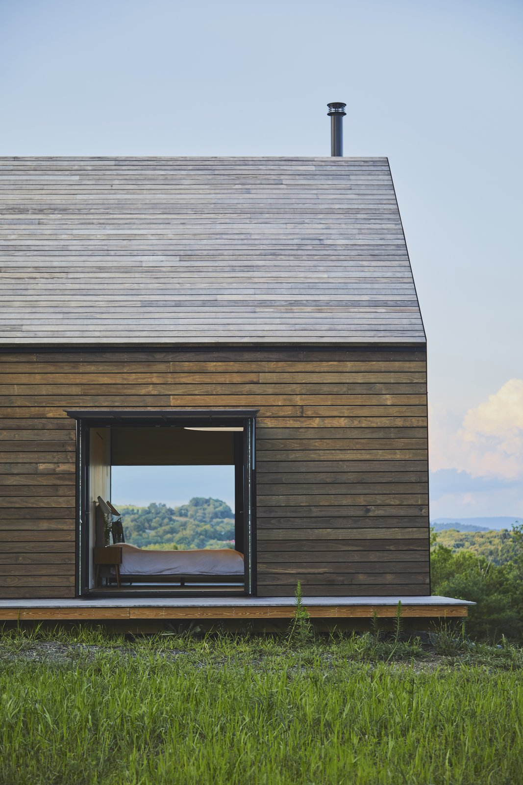 Exterior, Barn Building Type, Wood Siding Material, Green Siding Material, House Building Type, and Gable RoofLine The home pays homage to the area's rural character, rich heritage, and building typology.  Best Photos from Mountain House