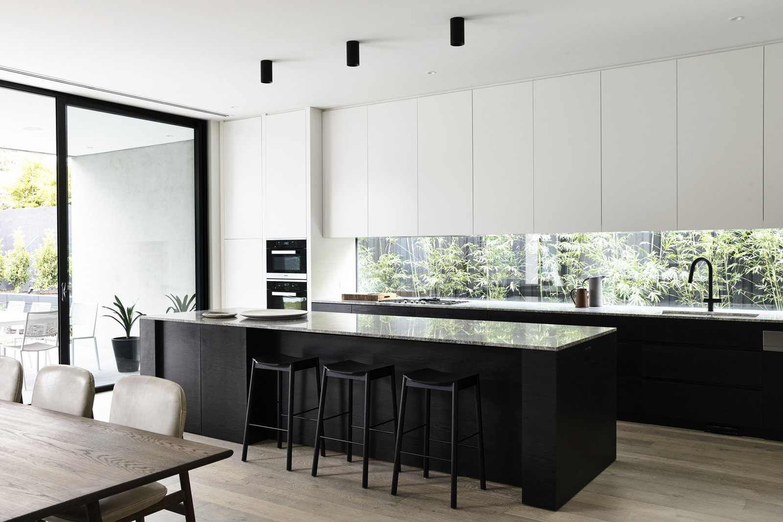 Kitchen, Marble Counter, Drop In Sink, Dishwasher, Wall Oven, Ceiling Lighting, Microwave, Light Hardwood Floor, and Wood Cabinet Canny 'The New' Kitchen  The New