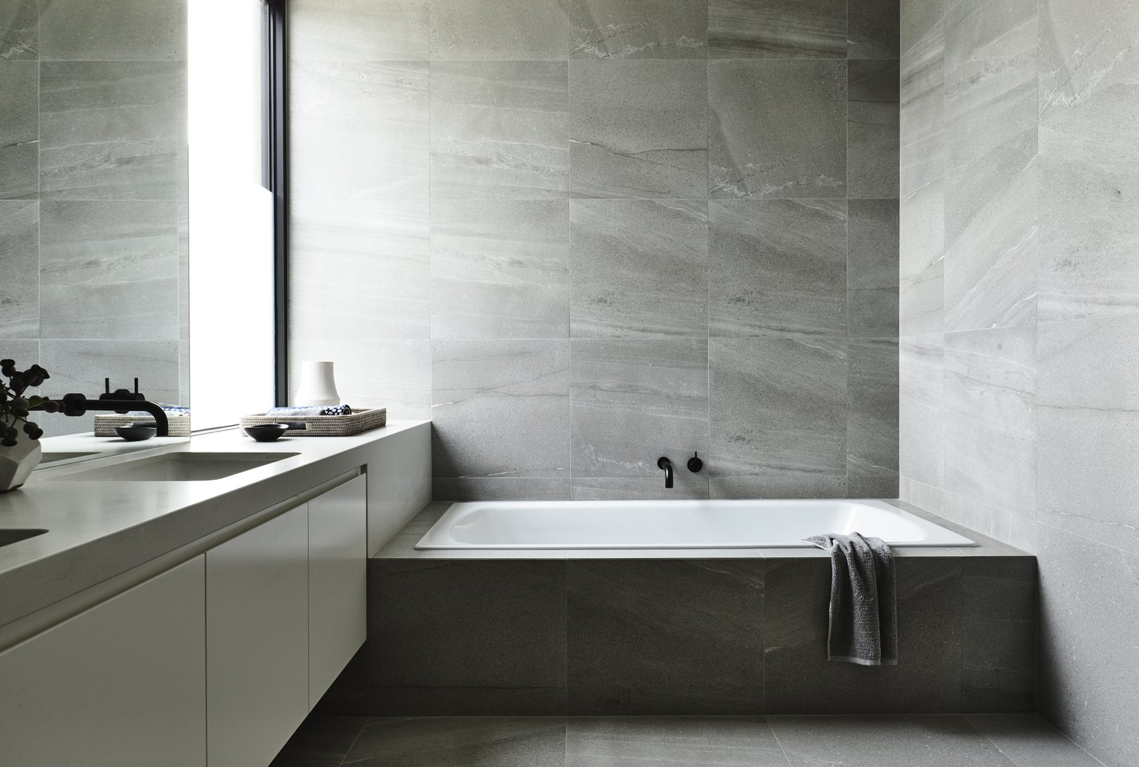 Bath Room, Drop In Tub, Porcelain Tile Floor, Porcelain Tile Wall, and Stone Counter Canny 'The New' Bathroom  The New
