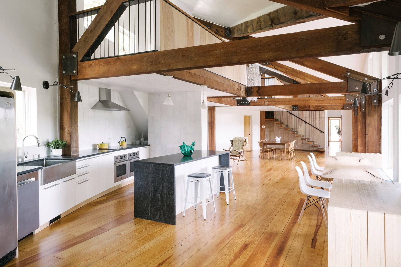 The expansive ground floor was further opened up with a new balcony design, great stairs, and a new kitchen that creates a home ideal for both large entertaining and intimate family dinners.