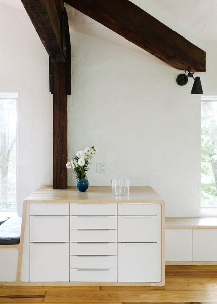 The plywood wrapper ties the kitchen together as it wraps over and around IKEA cabinets.