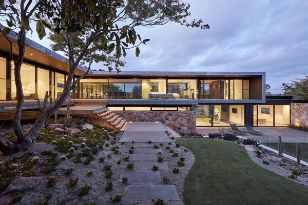 The South Elevation provides complete transparency through the main level to established gardens beyond