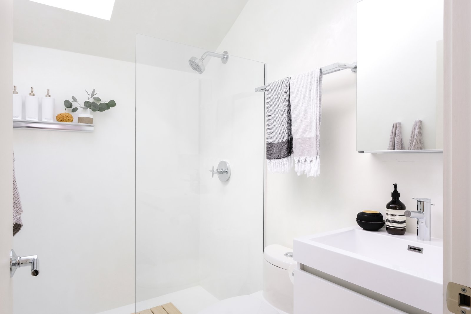 Bath Room, One Piece Toilet, Open Shower, Ceiling Lighting, Wall Mount Sink, Concrete Counter, Concrete Floor, and Concrete Wall The bathroom is bright, clean and beautiful - everything you want a bathroom to be.  Best Photos from 111 House
