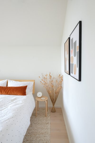 The second bedroom has art and accessories from local Portland shops Schoolhouse Electric and Sitte Modern.