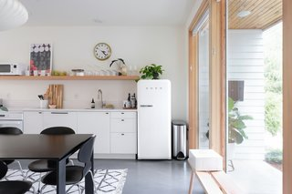 The kitchen was designed to blend with the open floor plan. The SMEG refrigerator was chosen to feel like a piece of furniture and many of the household items add a sculptural quality.