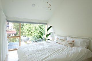 This bedroom has a king bed, blackout shades and a white noise machine for the lightest of sleepers to relax.