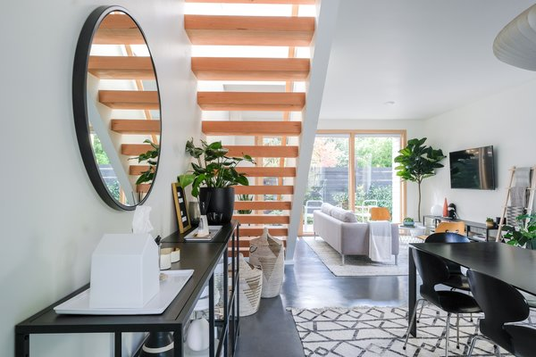 The open staircase brightens the space and makes it feel spacious and beautiful.