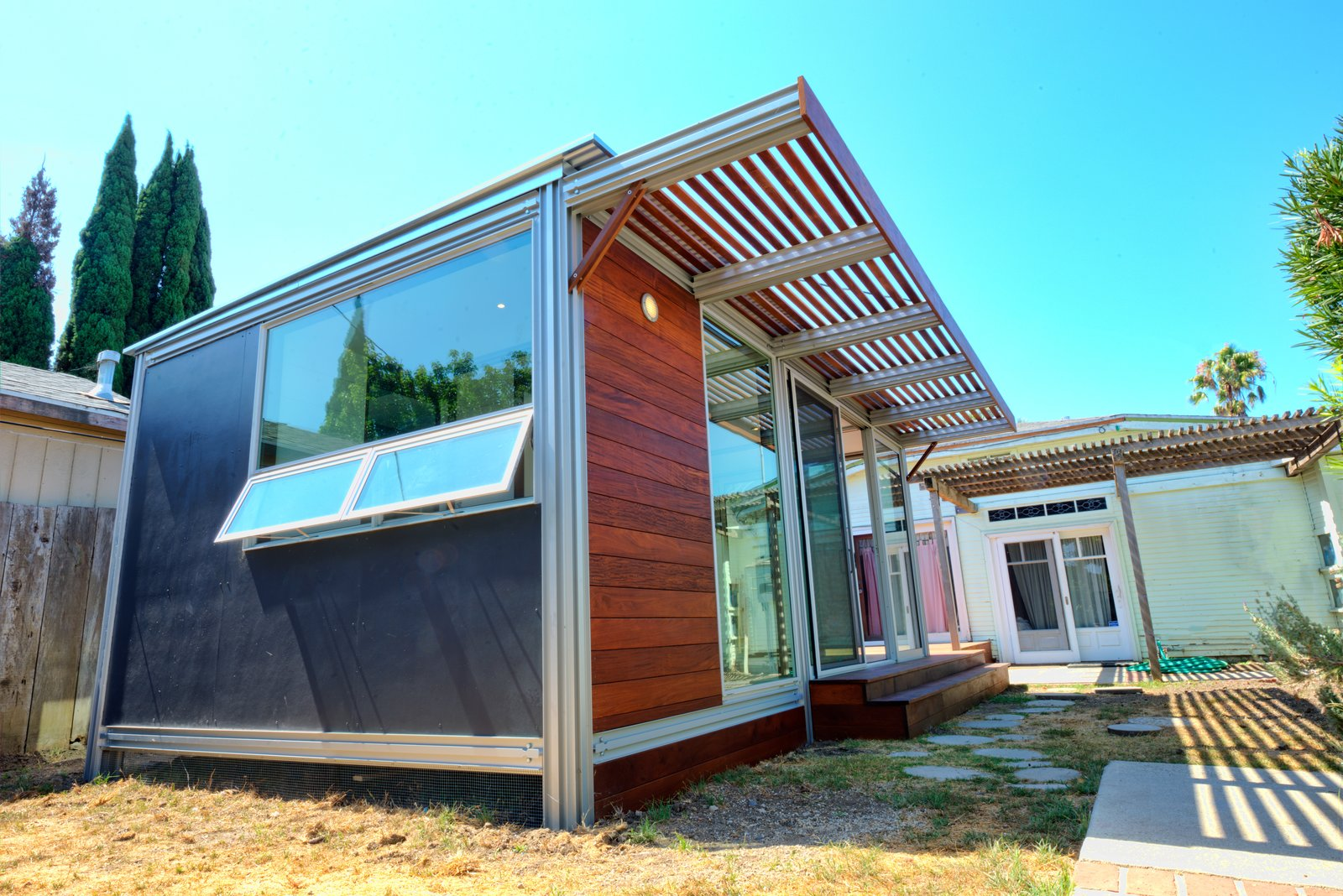If you're willing to sacrifice space for a super-low price tag in your search for modular homes under $10K, the K3 by KitHaus is an option. It's adaptable as a backyard studio, home office, pool house, or play room, to name a few options. Its exterior is clad in corrugated galvalume or smooth, natural cement board with corrugated roofing, and floors are natural hardwood or finished plywood.
