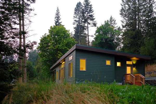 Exterior, Prefab Building Type, and Wood Siding Material Constructed with durable Montana timber, corrugated metal roofing and energy-efficient windows, the FUSE 2 by Ideabox is a 1360 square foot modular home.  Photo 2 of 22 in Modern Modular Homes for Sale From $10K to $200K