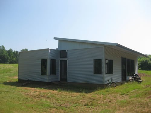 Designed by architect David Day and manufactured and constructed by Green Modern Kits, Casa Ti is a passive solar, one-story modern modular with a whopping 1,200 square feet and three bedrooms. That makes it one of the largest modular homes under $40K that we've seen.