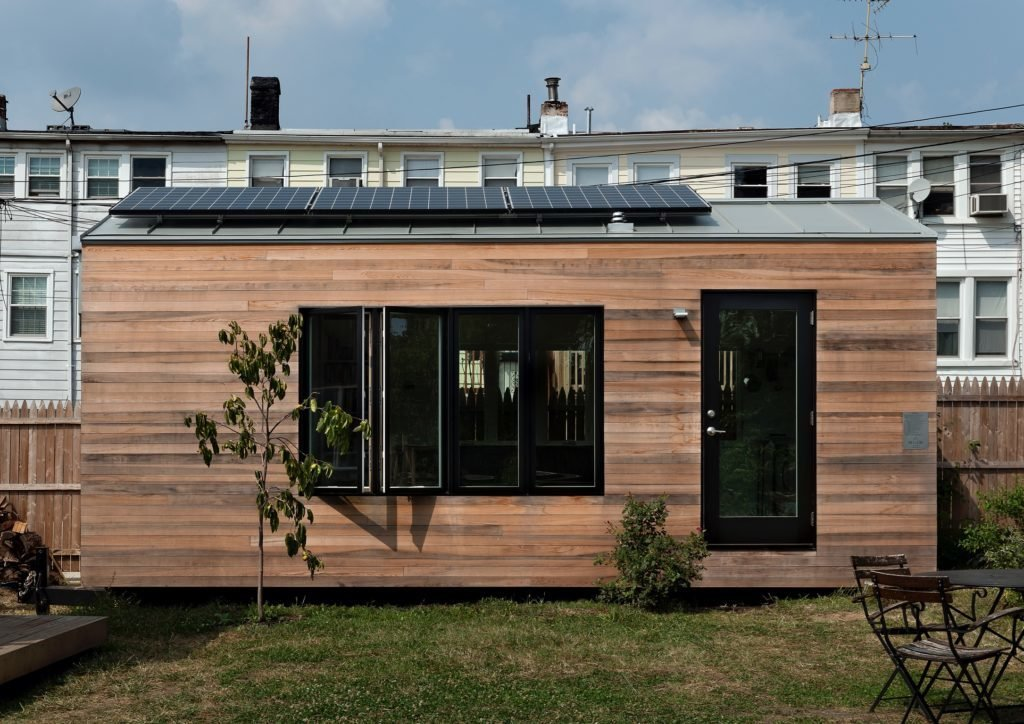 Exterior, Wood Siding Material, Flat RoofLine, Metal Roof Material, and Prefab Building Type Minim Homes are wrapped in beautiful, shiplapped cyprus that will gently age to grey. And a 960-watt solar array on the roof can be battery powered, allowing the home to be completely off-grid if desired.