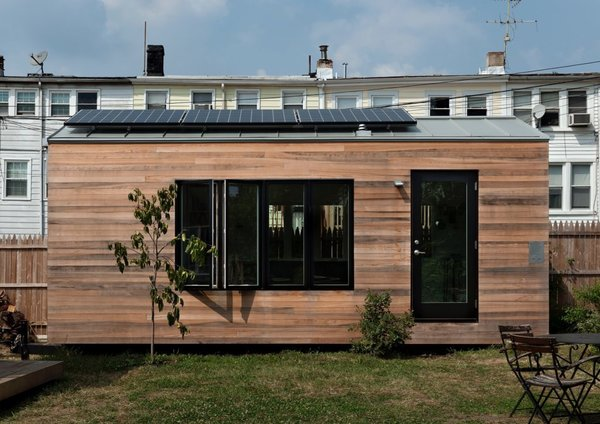 Minim Homes are wrapped in beautiful shiplapped cyprus that will gently age to grey. And a 960-watt solar array on the roof can be battery powered, allowing the home to be completely off-grid if desired.