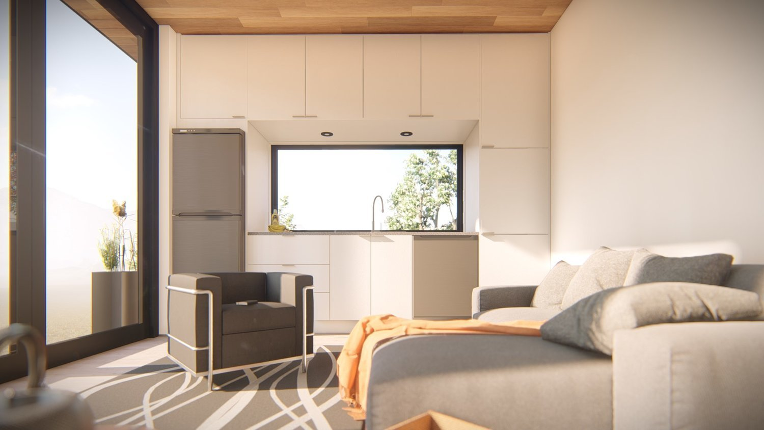Offering a truly seamless indoor/outdoor experience with floor-to-ceiling windows, the M Studio, like all Honomobo models, can be customized with a variety of upgrades, like this high-gloss white cabinetry and premium countertop.