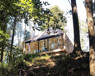 The Hut rests peacefully on a bank overlooking the lake.
