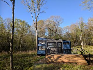 Solar panels on the roof of the Penner cabin provide all the electricity it needs. The cabins are mobile to reduce the impact to the land, and to take advantage of different locations depending on the season.