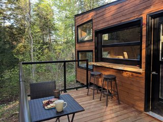 In the warmer months, the window can be raised to allow those on the deck and inside the cabin to chat face-to-face.