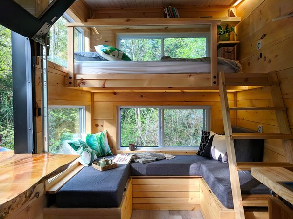 Plenty of sitting areas can be found in the Joni cabin, which comfortably sleeps three guests. A wood-and-glass railing along the bunk bed ensures natural light isn't blocked by the loft area, and allows a warm summer breeze to circulate.