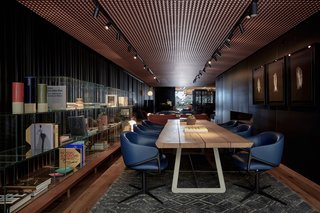 The material palette darkens in the study, which is stocked with books on art and culture.
