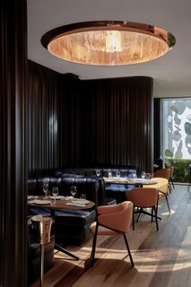 The hotel's restaurant, Mr. Porter, is a contemporary steakhouse with padded leather banquettes and immense copper-rimmed skylights.