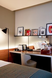 Local books and artwork bring Barcelona's vibrant culture into the guest rooms.