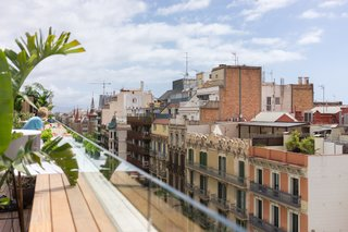 Panoramic views look out over Eixample district rooftops and Gaudí's Sagrada Familia.