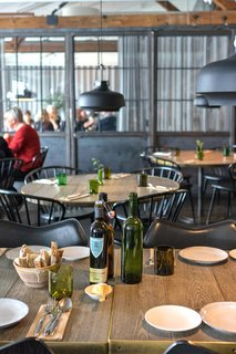 Fotografiska's restaurant serves a plant-based menu in a cozy, industrial-chic setting.