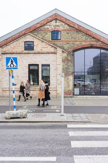 Wingårdh Arkitektkontor AB transformed an abandoned 1898 freight depot into Malmö Saluhall—a culinary wonderland filled with regional delicacies.