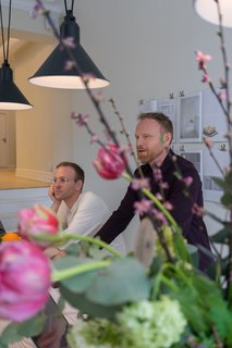 Partner Ola Kjellander (right) discusses plans to transform Malmö's Sege Park into a new sustainable district with centralized hubs that share tools and resources for the entire community.
