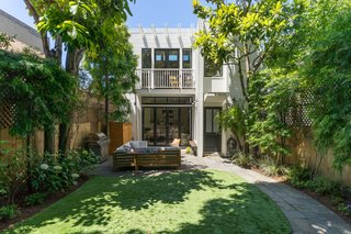 The Potrero Hill home has a lush front yard with a huge, locally famous avocado tree.