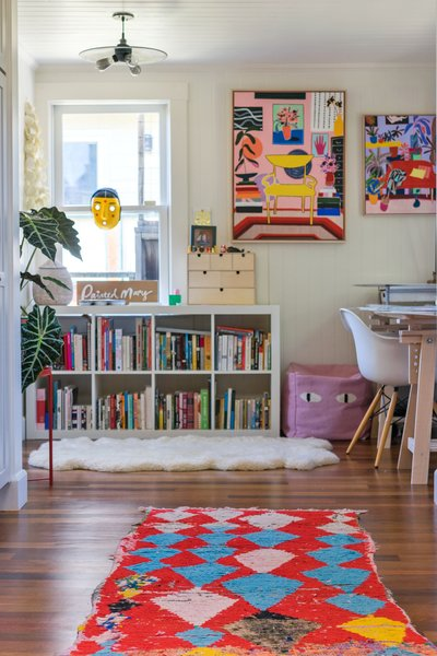 A vivid Moroccan rug leads to Finlayson's home office and studio.