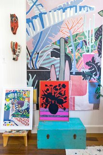 An array of Finlayson's past paintings and textiles adorns her studio.