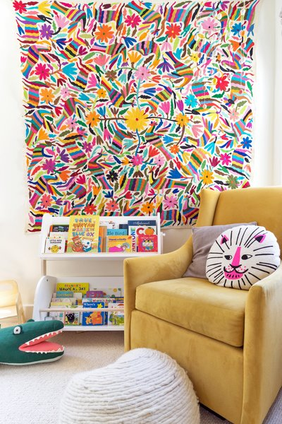 Frances's room is filled with color, plush textures, and lots of books.