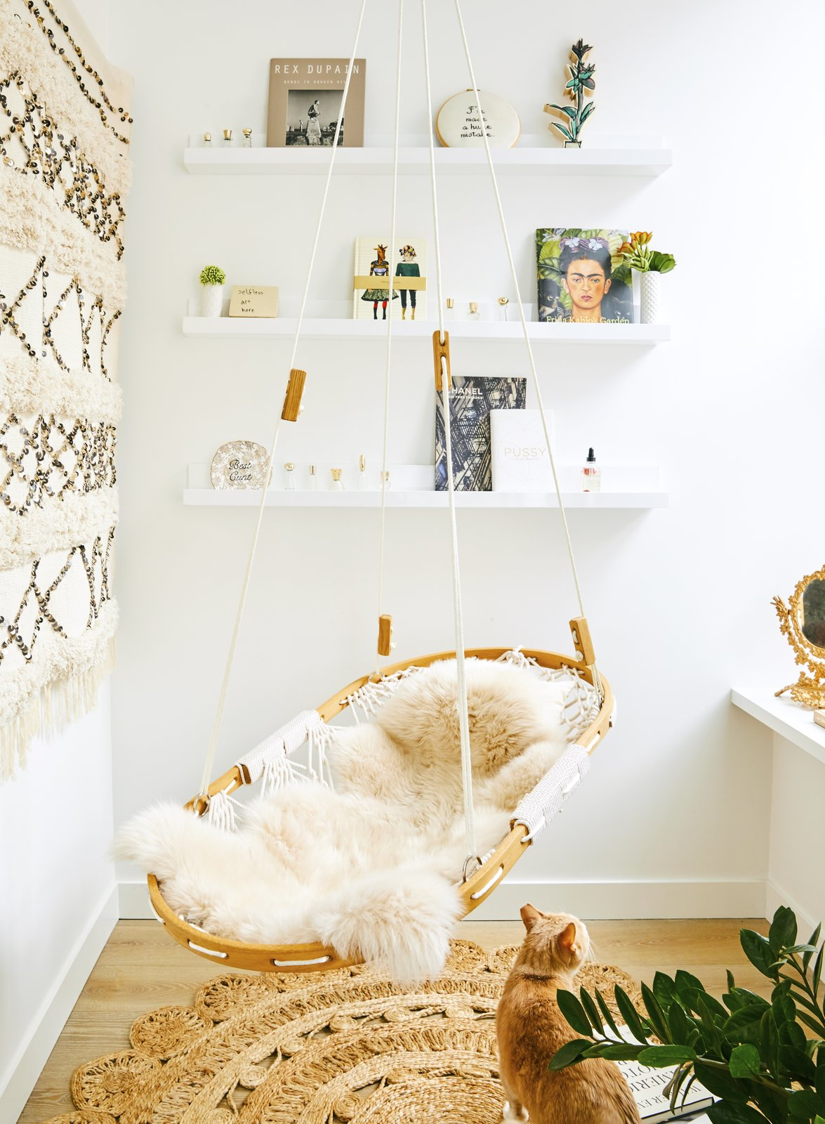 Crosby Loft nook with hanging chair and cat