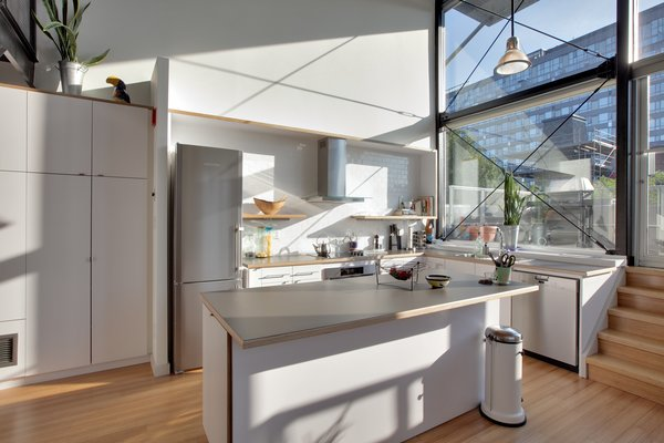 PLANT Architect Inc. reworked the kitchen in the Berkely Live/Work Residence; it's now an airy, open social area.