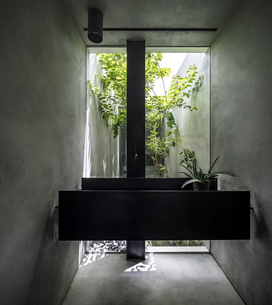 The black iron sink designed by Anderman.