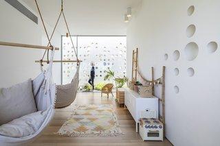 The playroom wall mimics the exterior.