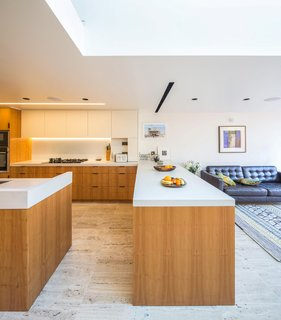 Hardwearing quartz is used on the kitchen worktops. The cupboards are made from yew veneer.