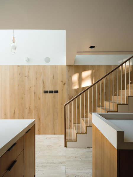 Hardy frosted oak panels line the kitchen staircase.