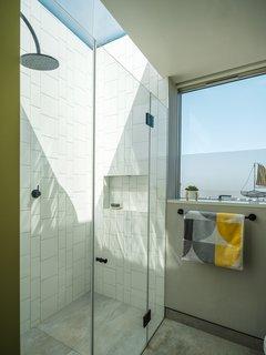 The family bathroom has a retractable skylight.