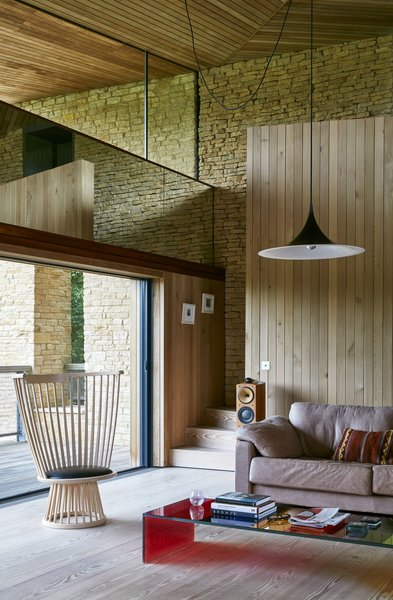 Douglas fir floors and cedar wall and ceiling panelling create a warm atmosphere in the living room.