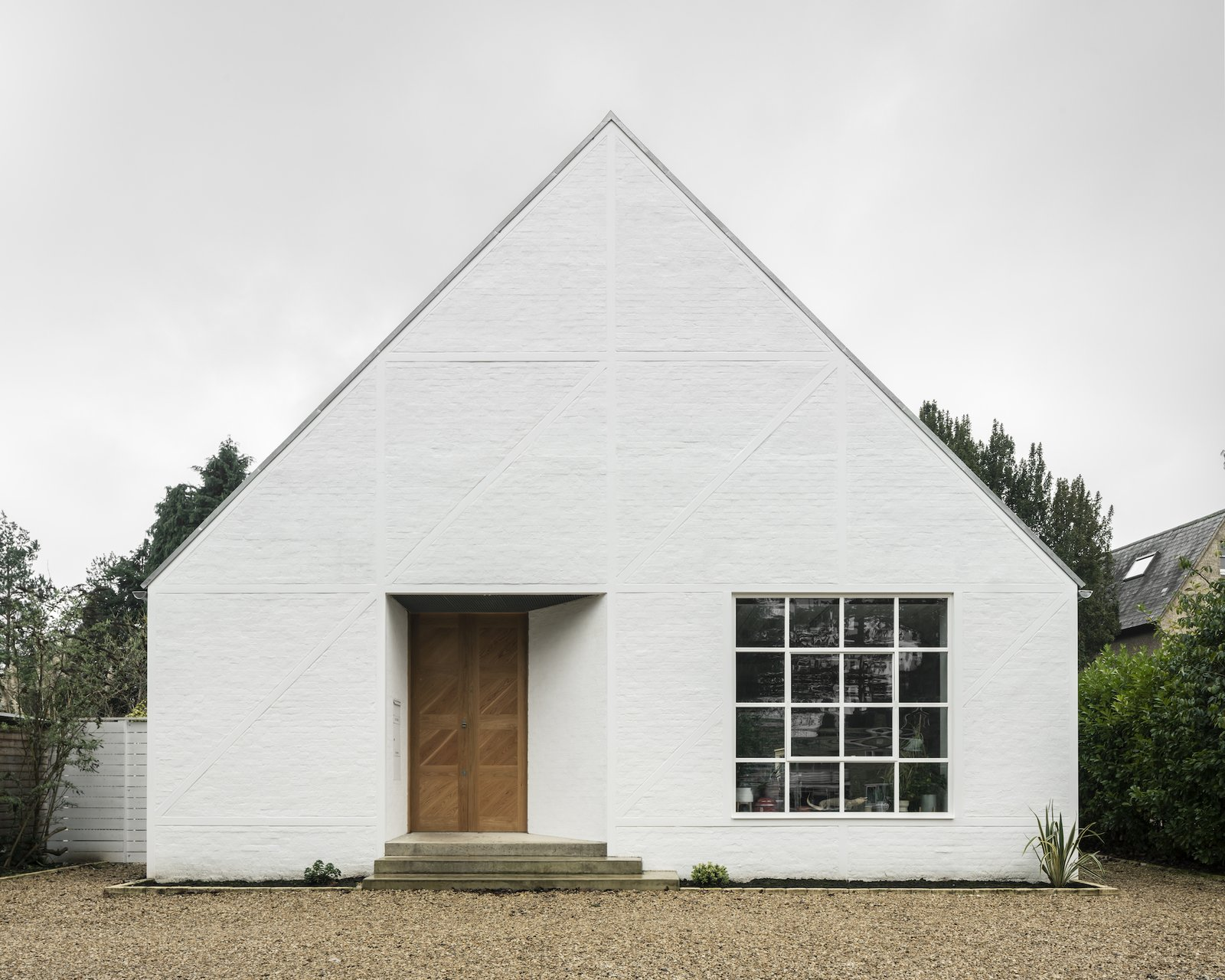 Exterior, House Building Type, Brick Siding Material, and A-Frame RoofLine The exterior of Ditton Hill House, an A-frame new-build  Photo 8 of 8 in Dazzling Brickwork Brightens Up a Tudor Revival Home in London