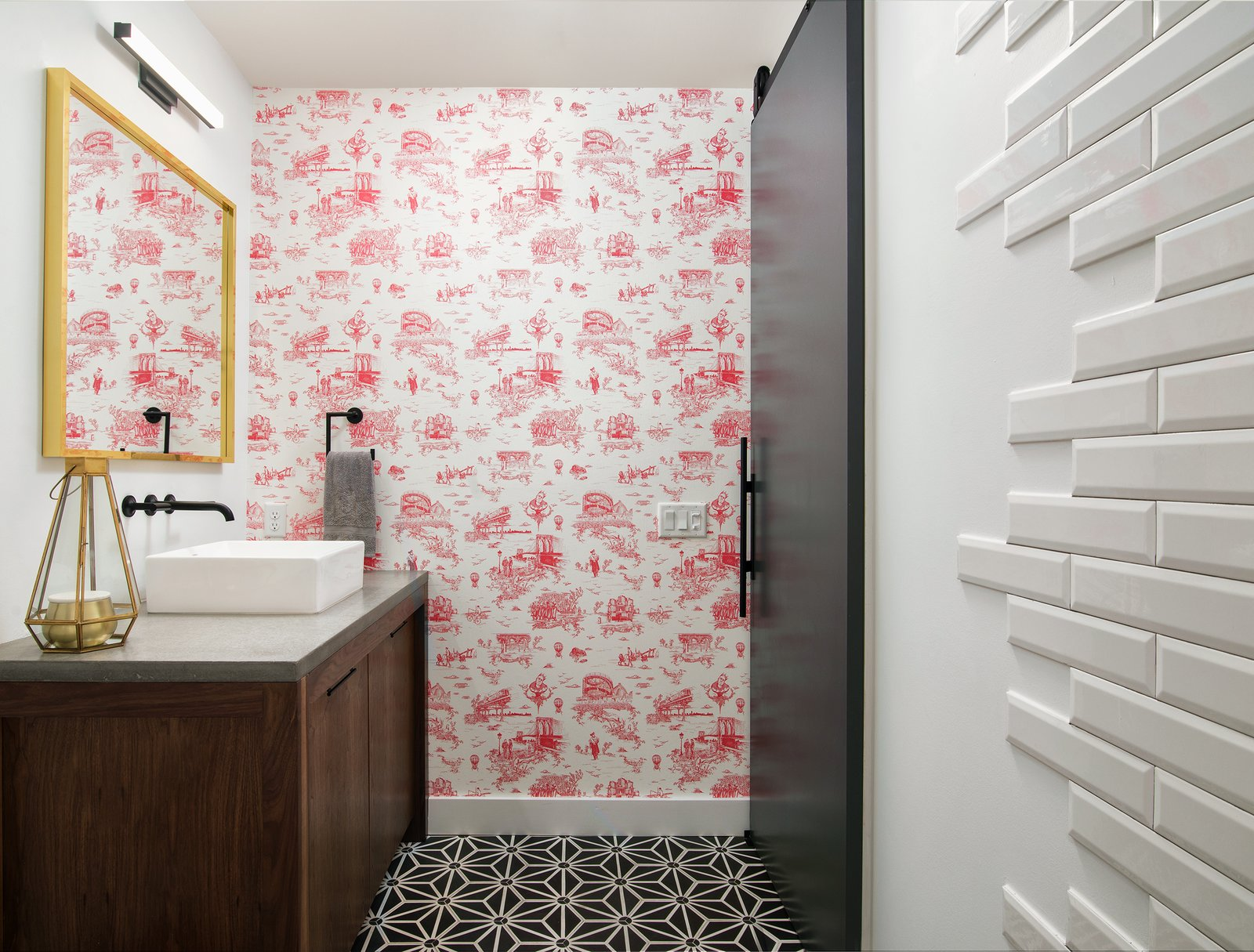 Bath Room, Ceramic Tile Wall, Ceiling Lighting, Vessel Sink, Concrete Counter, Subway Tile Wall, Concrete Floor, and Wall Lighting Guest Bath Detail  400 SOLA