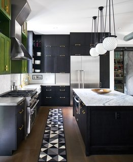 400 SOLA's impressive kitchen is a mix of colors and textures. Homeowner Tobin Green designed the space to mesh many different styles in a way that feels urban and organic.