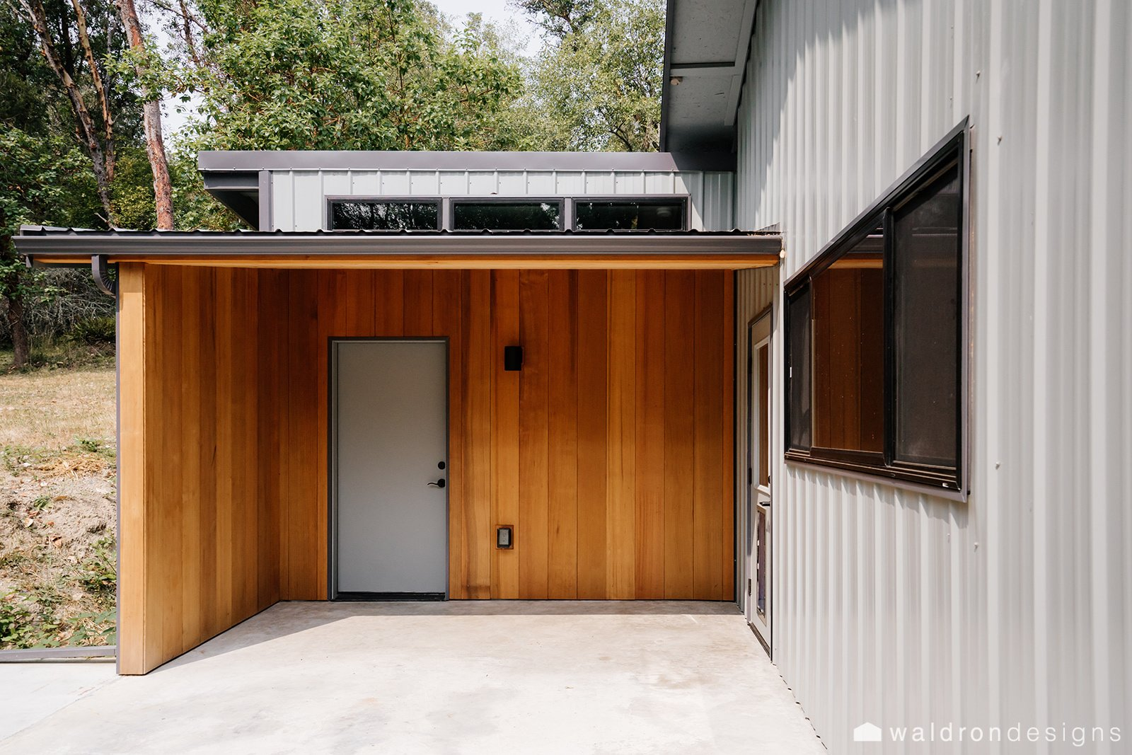 As a pet-sitter, this homeowner uses this space out back to dry off the dogs before they run inside!  Vashon Hangar Conversion