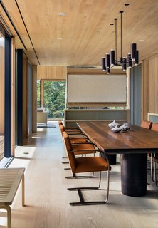 The woodwork in the Chilmark House dining room is especially stunning; Schiller Projects designed, built, and collaborated on many of the freestanding furniture pieces in the house.