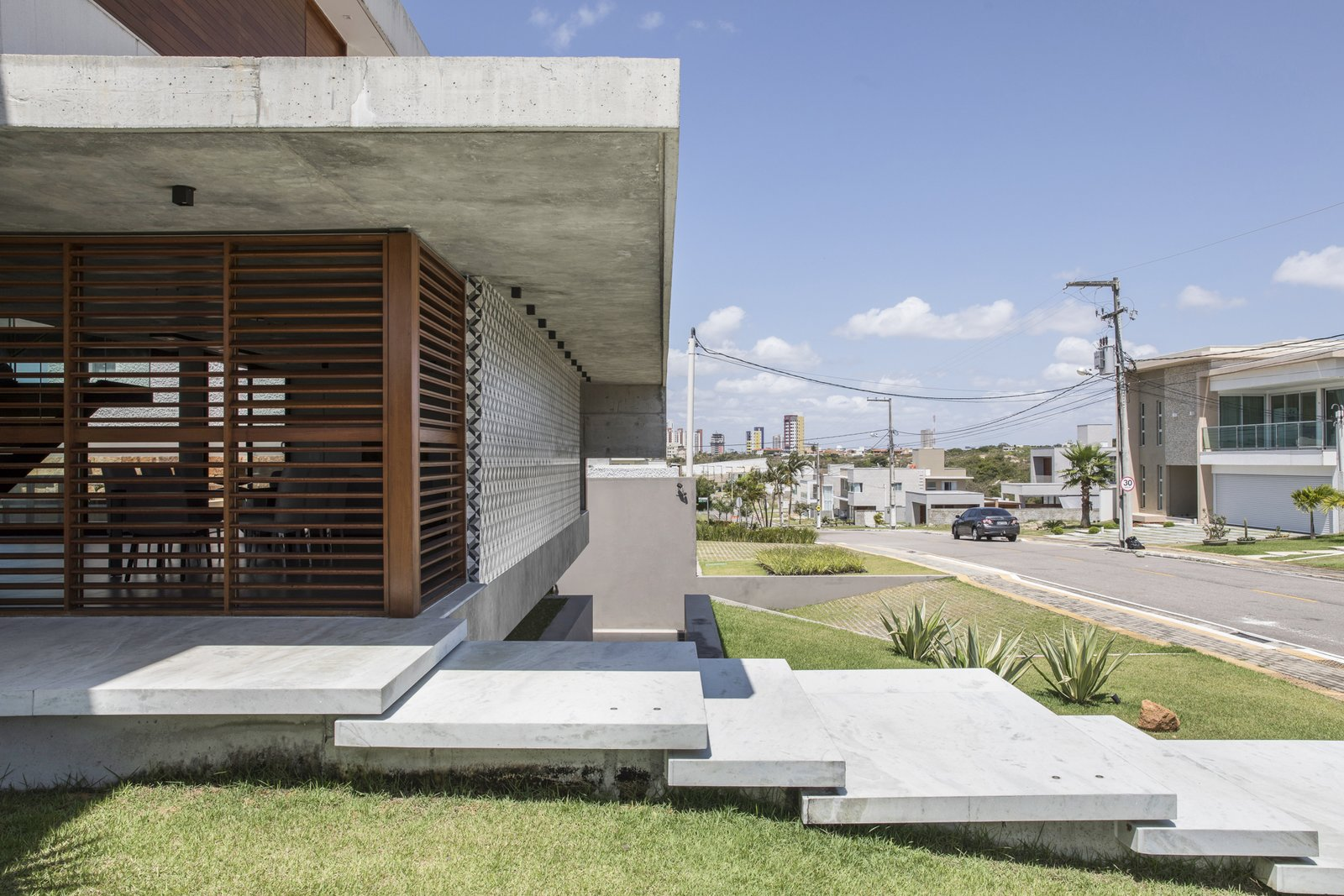 Exterior, Flat RoofLine, House Building Type, Green Roof Material, Beach House Building Type, Wood Siding Material, Concrete Siding Material, Stone Siding Material, and Green Siding Material IF House - Photo 11  Photos from IF House