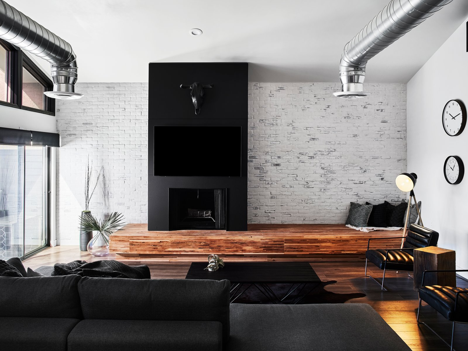 Living, Vinyl, Bench, Wood Burning, Sectional, and Recessed Whitewashed brick wall, Maple butcher block bench/hearth, Fenix & Steel fireplace by Lignum Cabinets  Best Living Bench Wood Burning Photos from Waterfall House