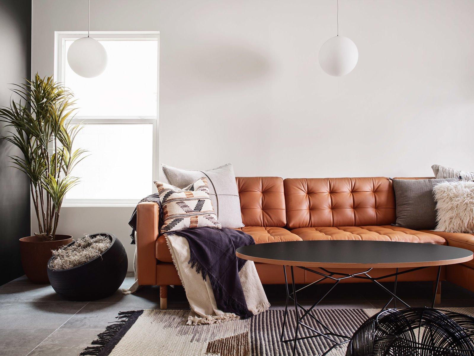Living Room, Porcelain Tile Floor, Pendant Lighting, and Sectional Living room w/ pendant lights above the seating area  Details