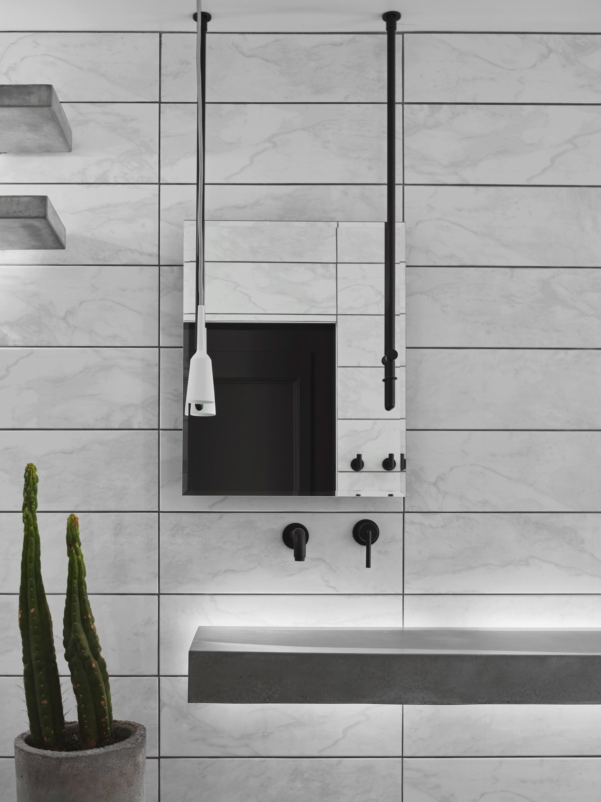 Bath Room, Wall Mount Sink, and Concrete Counter The floating drain-less custom sink with led backlighting with matching corner shelves by Compound Concrete. Paired with hanging mirror and pendant outlet.  Details